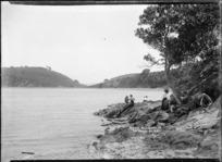 Women exploring the rocky foreshore, Awaawaroa Bay, Waiheke Island