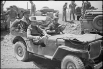Prime Minister Peter Fraser in a jeep with General Bernard Cyril Freyberg, Cassino, Italy - Photograph taken by George Frederick Kaye