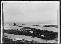 View of the breakwater at the mouth of the Turanganui River, Gisborne