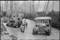 Drivers of New Zealand Division vehicles, washing down trucks in a stream near Alife, Italy - Photograph taken by George Frederick Kaye