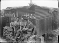 New Zealand soldiers outside a captured German hut