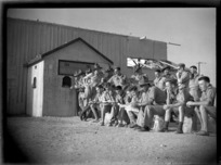 World War II soldiers waiting outside the cinema at Maadi Camp, Egypt - Photograph taken by George Kaye