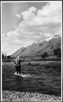 Woman crossing the Hunter River, Otago