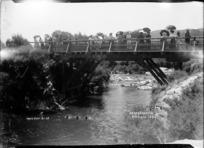 Children diving for pennies from the bridge at Whakarewarewa