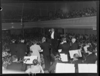 Selwyn Toogood conducts the National Orchestra at the Town Hall, Wellington