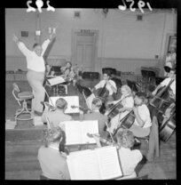 Conductor Selwyn Toogood leads a National Orchestra rehersal, with musicians including cellists, double-bassists, violinists and viola players