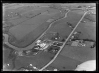 View of the Awanui River, Dairy Factory, Primary School and the Far North Road (State Highway 1F) surrounded by farmland, Northland Region