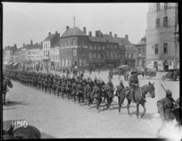 New Zealand troops marching through Bailleul, France