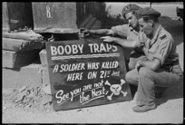 Sign warning soldiers about booby traps, on a road near Sora, Italy, during World War II - Photograph taken by George Kaye