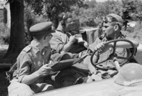 World War II soldiers from New Zealand during a signals communication from a reconnaissance jeep outside Sora, Italy, just before the town fell - Photograph taken by George Kaye