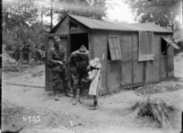 New Zealand soldiers buying sweets from a French girl, World War I