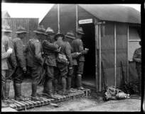 New Zealand troops drawing pay at the reinforcement camp before going on leave