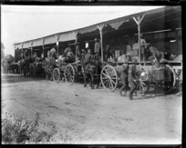 Soldiers and carts at the NZASC ration dump, Steenbecque France