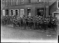 New Zealand soldiers waiting for the canteen to open, Solesmes, France, World War I