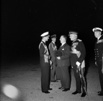 The Duke of Edinburgh in naval uniform talking to Sid Holland, Prime Minister of New Zealand