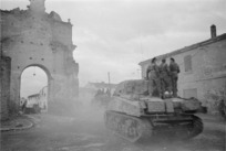 Kaye, George, 1914- : NZ Sherman tanks moving out of the town of Forli, Italy, to engage the enemy