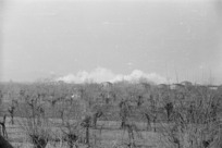 Faenza, Italy, during World War II, with clouds of smoke - Photograph taken by Goerge Frederick Kaye
