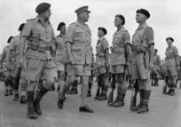 Brigadier Lindsay Inglis and Lieutenant Colonel R L McGaffin inspecting members of the 19th Armoured Regiment