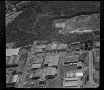 Unidentified factories in industrial area, Auckland, including land cleared for development and bush-clad area [Mt Wellington?]