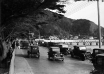 Scene at Days Bay, Eastbourne, showing cars on Eastern Bays Marine Drive