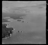 Whangamata Harbour, including Slipper Island in the background