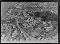 Close-up view over Wanganui Public Hospital, surrounded by residential housing showing Tawa Street and Gonville Street intersection, Carlton Avenue foreground and Heads Road, and the Wanganui River looking southwest