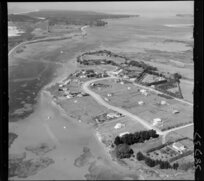Bowentown, Tauranga, Bay of Plenty, showing view of a peninsula with tidal flats, northern section of Tauranga inner harbour, with housing along Athenree Road and Roretana Drive, looking out to Bowentown Heads and harbour entrance beyond