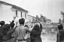 Kaye, George, 1914- : Inhabitants of the town of Barbiano, Italy, greeting entering NZ tanks