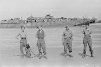 Members of 21 New Zealand Battalion with a surrendered German naval craft, near Lignano, Italy, during World War II