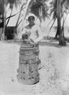 Man playing a village drum