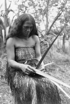 Māori woman weaving