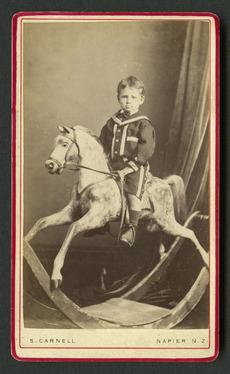 Portrait of a boy on rocking horse