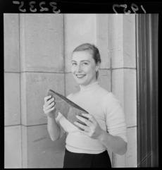 Miss Susan Davis holding a 500 year old moa hunter greenstone [pounamu] adze
