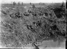 Engineers resting in a large shell hole