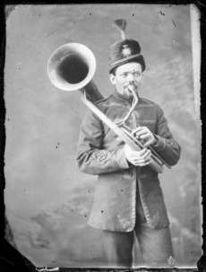 Military band member with helicon
