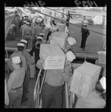 American sailors loading meat for Niue relief