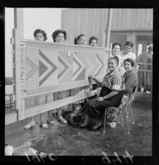 Women working on a tukutuku panel