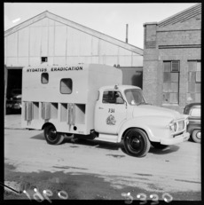 A Wellington City Council Hydatids Eradication Bedford van with external dog cage compartments on a unknown street, probably Wellington City