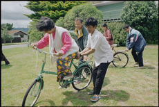 Cambodian refugees learning to ride bicycles in Waikanae