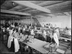 Women packing chocolates at Atlas biscuit and confectionery company
