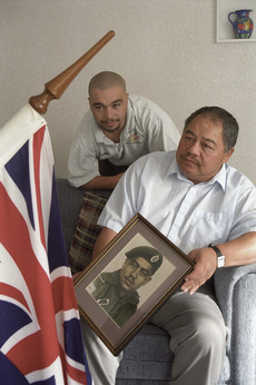 William and Hoa Awatere with a photograph of their uncle and brother who was killed serving in the Vietnam war - Photograph taken by John Nicholson