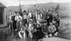 School children with gardening tools