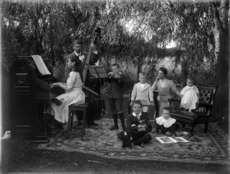 James McAllister and family, outside, with musical instruments