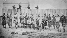 Captain Thomas Porter with his Maori auxiliaries outside a stockade and blockhouse
