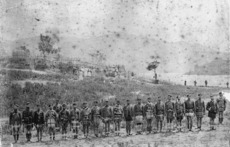 Mundy, Daniel Louis, 1826-1881: Photograph of Captain Mair's Flying Column returning after the fight with Te Kooti at redoubt at Kaiterira, Lake Rotokakahi