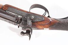 Tupara (double-barrelled shotgun).