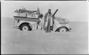 L/Cpl W R Adams alongside bogged Long Range Desert Group truck, Libya