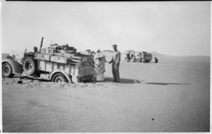 Trucks of Long Range Desert Group bogged in dune country, Libya
