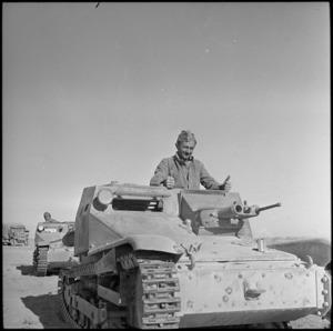 NZ driver examining Italian tank, Western Desert