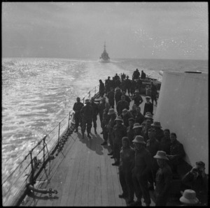 NZ troops on quarterdeck of warship sailing to Greece